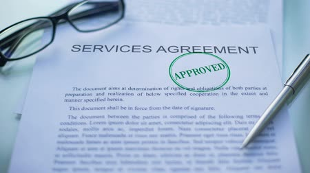 заем : Services agreement approved, officials hand stamping seal on business document