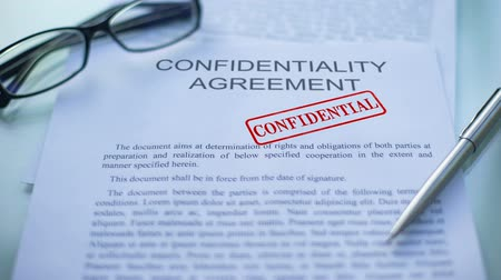законодательство : Confidentiality agreement confidential, hand stamping seal on business document