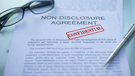 notarize : Non-disclosure agreement confidential, hand stamping seal on business document