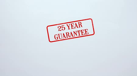 négyszögletes : 25 Year Guarantee seal stamped on blank paper background, product quality