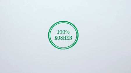 İbranice : 100 percent Kosher seal stamped on blank paper background, food quality control Stok Video