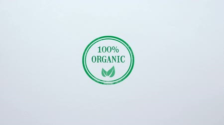 aprovado : 100 percent Organic seal stamped on blank paper background, food quality control