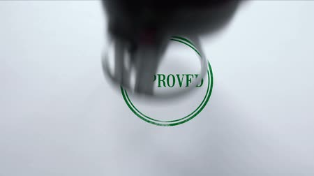 potvrzení : Certified seal stamped on blank paper background, product quality control