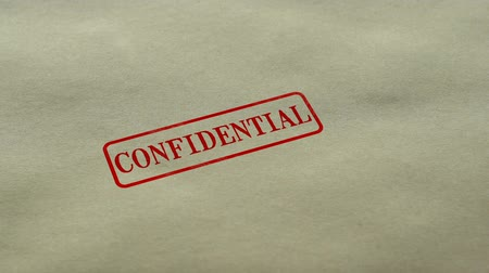 belgeleme : Confidential seal stamped on blank paper background, personal data nondisclosure