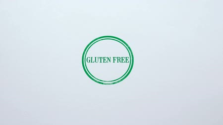 sealed : Gluten Free seal stamped on blank paper background, healthy dieting, nutrition