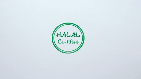 jóváhagyott : Halal Certified seal stamped on blank paper background, food quality control