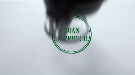legislação : Loan Approved seal stamped on blank paper background, business document
