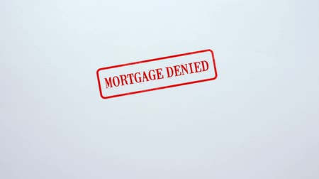 notarize : Mortgage Denied seal stamped on blank paper background, business document Stock Footage