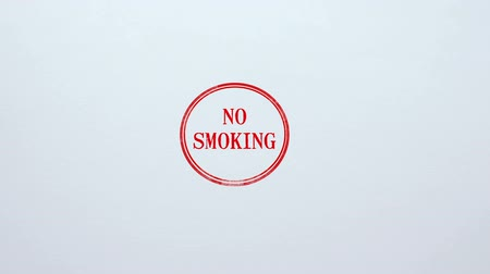 abandonar : No Smoking seal stamped on blank paper background, bad habit restriction