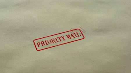 poczta : Priority Mail seal stamped on blank paper background, fast delivery service Wideo