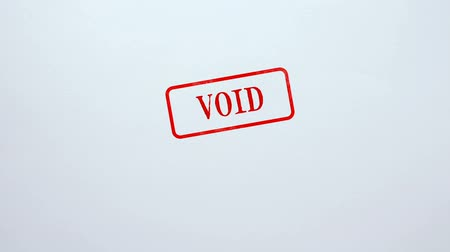 vacant : Void seal stamped on blank paper background, invalid contract, password Stock Footage