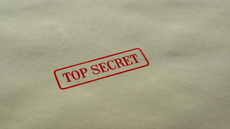 byrokracie : Top Secret seal stamped on blank paper background, restricted access, closed Dostupné videozáznamy