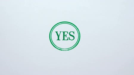 veredito : Yes seal stamped on blank paper background, access allowed, choice made Vídeos