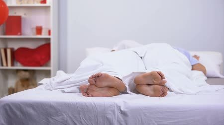 seeping : Husband and wife sleeping in bed, healthy feet seen under blanket, antifungals