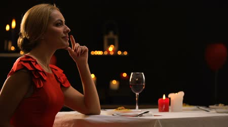 seduce : Beautiful lady happy to see boyfriend with bunch of roses, dinner in restaurant Stock Footage