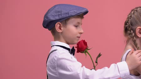 jealous : Young gentleman with rose trying to apologize his offended girlfriend, love