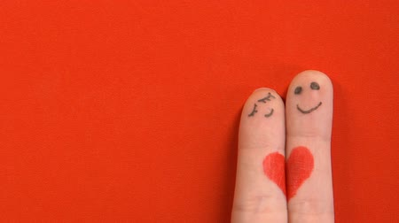 art : Two finger faces with painted heart hugging, romantic relationship, love concept Wideo