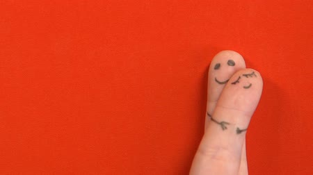 art : Finger faces man and woman hugging isolated on red background, Valentines day Wideo