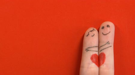 art : Finger face couple in love hugging, Valentines day celebration, red background
