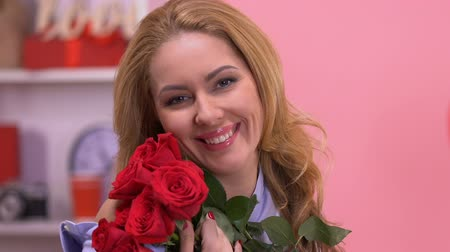 hayran olmak : Portrait of lady with roses, pleasantly surprised by gift on Valentines day