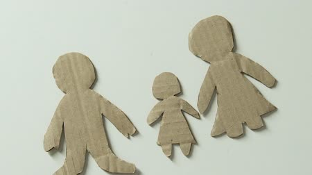 vazba : Child adding figure of father and toy heart to paper family lack of fathers love