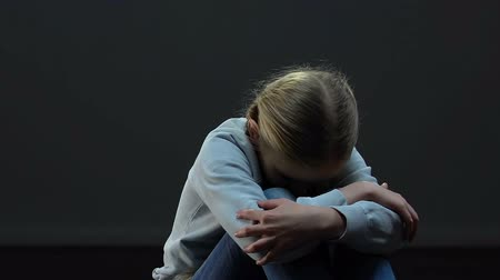 maltreatment : Scared little girl lonely sitting in empty dark room, punishment, maltreatment