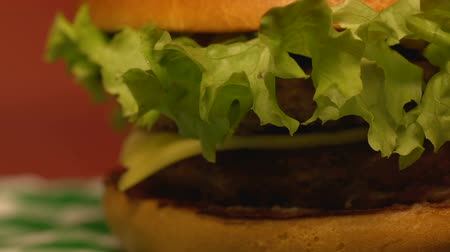 fries : Big delicious double cheeseburger on table in fast food restaurant, close up Stock Footage