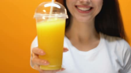 proposing : Smiling lady proposing fresh juice, healthy lifestyle, vitamins and energy