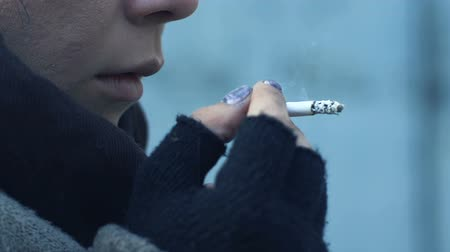 bum : Frozen female bum smoking cigarette standing outdoor, hard fate, homelessness Stock Footage