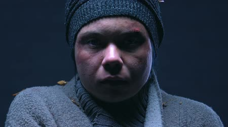 deprived : Portrait of young homeless woman crying, helpless living in poverty, closeup