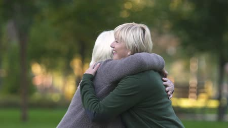 together trust : Adult daughter embracing old mother, long awaited meeting, sincere feelings Stock Footage