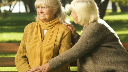 bereavement : Old woman supporting friend in trouble, coping together with loss, compassion