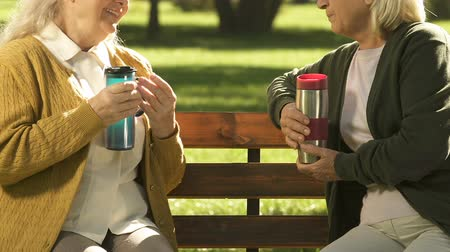 flasks : Elderly women drinking tea from flask, water balance in body, hydration Stock Footage