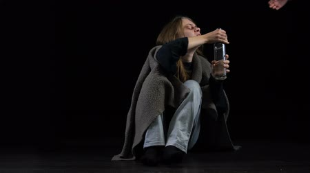 intimidated : Alcoholic female suffering withdrawal symptoms, taking greedily bottle of vodka