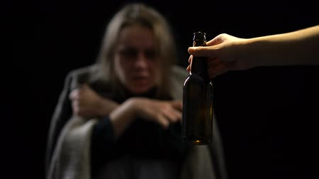 geri çekilme : Addicted female suffering withdrawal symptoms rejecting bottle of beer willpower