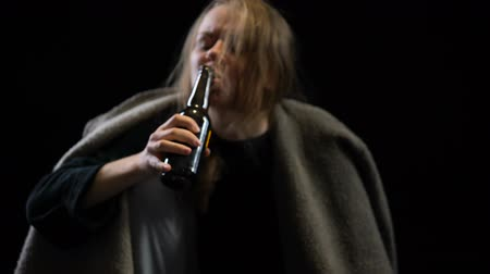 willpower : Alcohol addicted woman greedily drinking beer suffering withdrawal, shaking