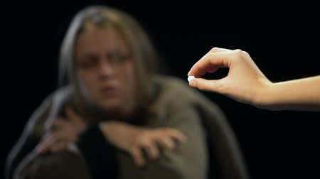 aşırı doz : Woman suffering withdrawal symptoms rejecting LSD pill, drug addicted person