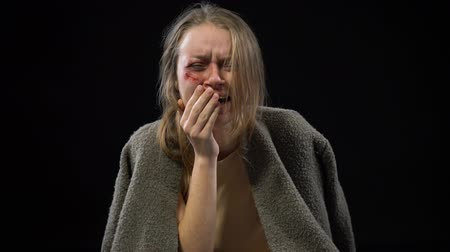 forced : Desperate sexual slavery victim with wounded cheek crying violence against women Stock Footage
