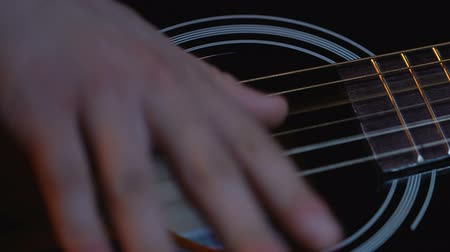 mansão : Close up of mans hands playing acoustic guitar, rock ballad singer, performance