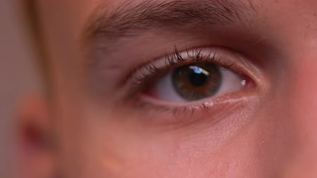 wistful : Close up of male eye looking at one point, thinking about life, depression