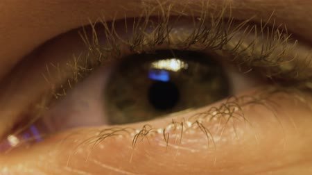 nearsightedness : Man having test in ophthalmology clinic, eye extreme close up, health problems