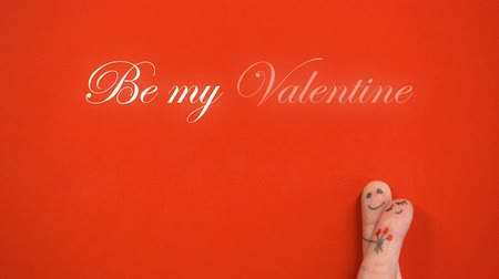 art : Be my Valentine phrase and hugging finger face couple with flowers, togetherness Wideo