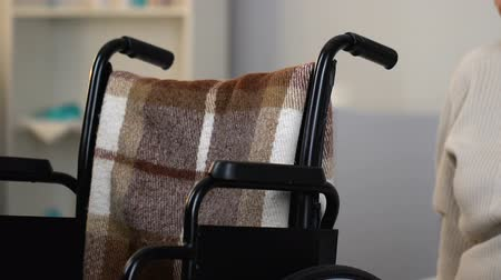 homesick : Unhappy lonely woman sitting in wheelchair in nursing home, feeling homesick Stock Footage