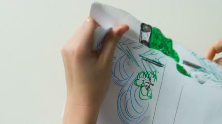タンクトップ : Little kid hands tearing up drawing with tank, hostilities, psychological trauma 動画素材