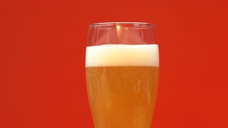 craft beer : Glass of cold light beer with foam, refreshing summer craft drink, close up