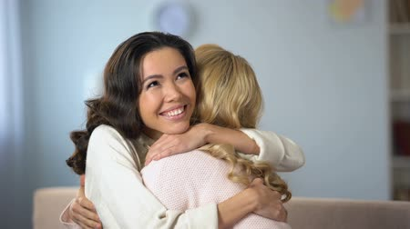 emancipation : Two young women hugging and sincerely smiling, true old friendship, indoors