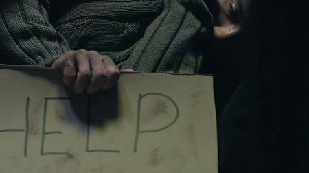 deprived : Homeless woman holding Help sign, social charity programs for low income people