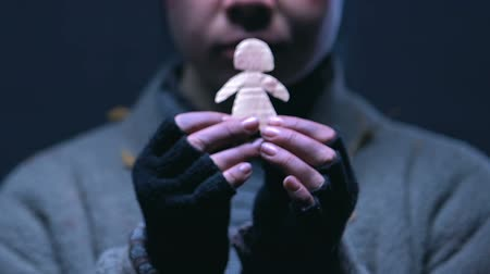 лучше : Homeless orphan hugging little paper man, dreaming of family and better life
