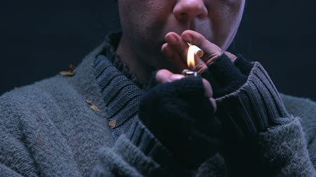 neglected : Beggar lighting cigarette, smoking addiction among homeless people, closeup Stock Footage