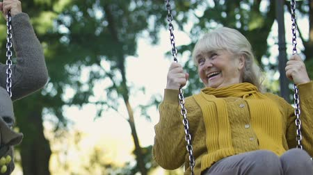 запомнить : Happy old women swaying, laughing sincerely, remembering childhood together Стоковые видеозаписи